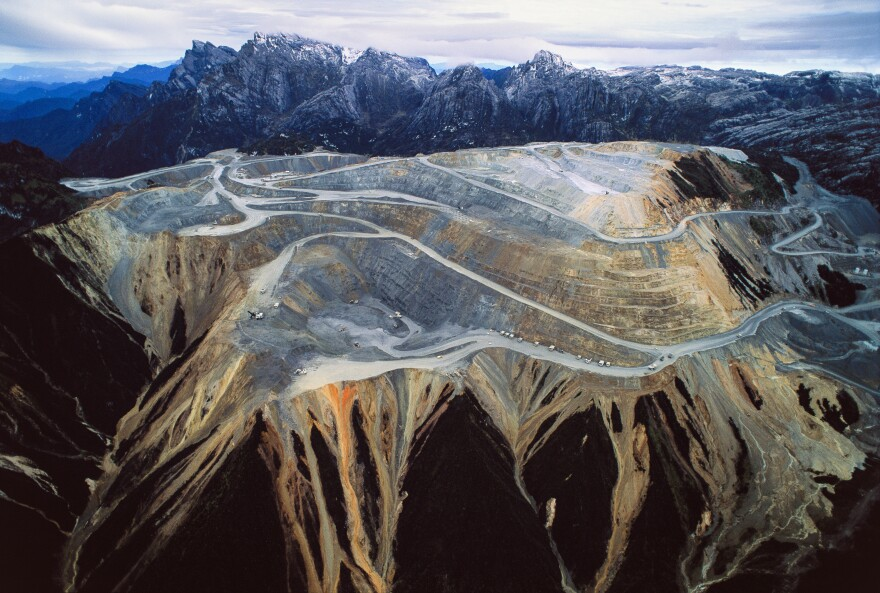 This mountain in Timika, Indonesia, was hollowed out for its gold and copper. The Grasberg mine is the world's largest gold mine — and a source of tension between the Indonesian state and citizens who blame it for flooding their lands.
