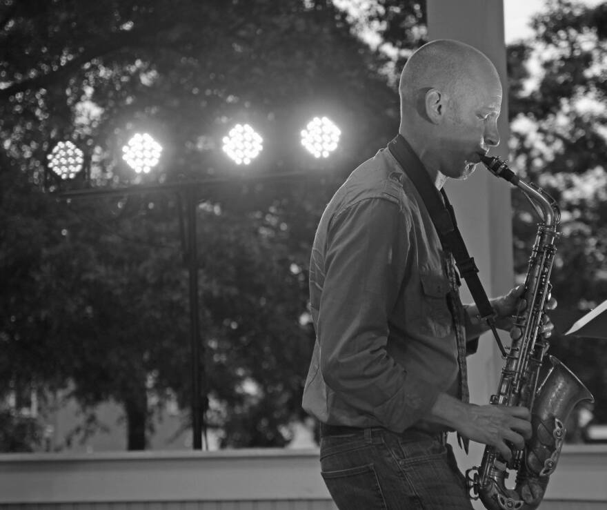 Picture of Bobby Selvaggio playing alto sax in concert.