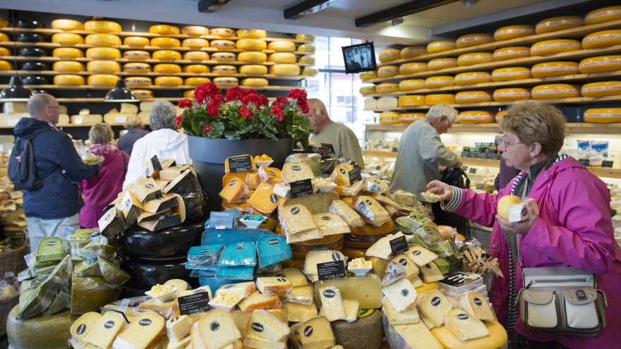 The European Union's highest court has ruled that a food's taste can't be copyrighted. Here, people shop for cheese in Gouda, Netherlands, in 2015.