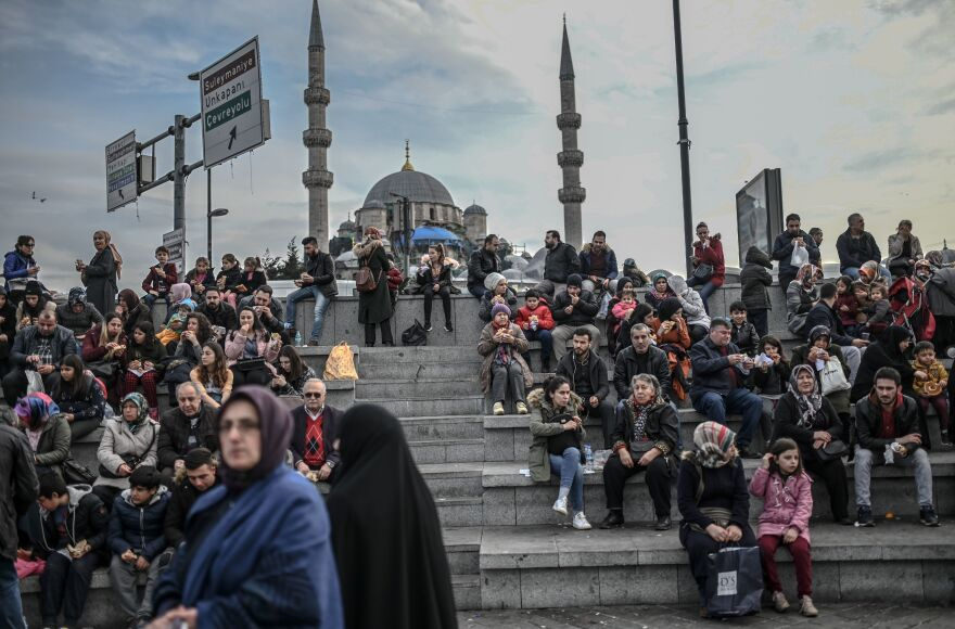 People enjoy a sunny afternoon at Eminonu Square in Istanbul on Jan. 29, 2019.