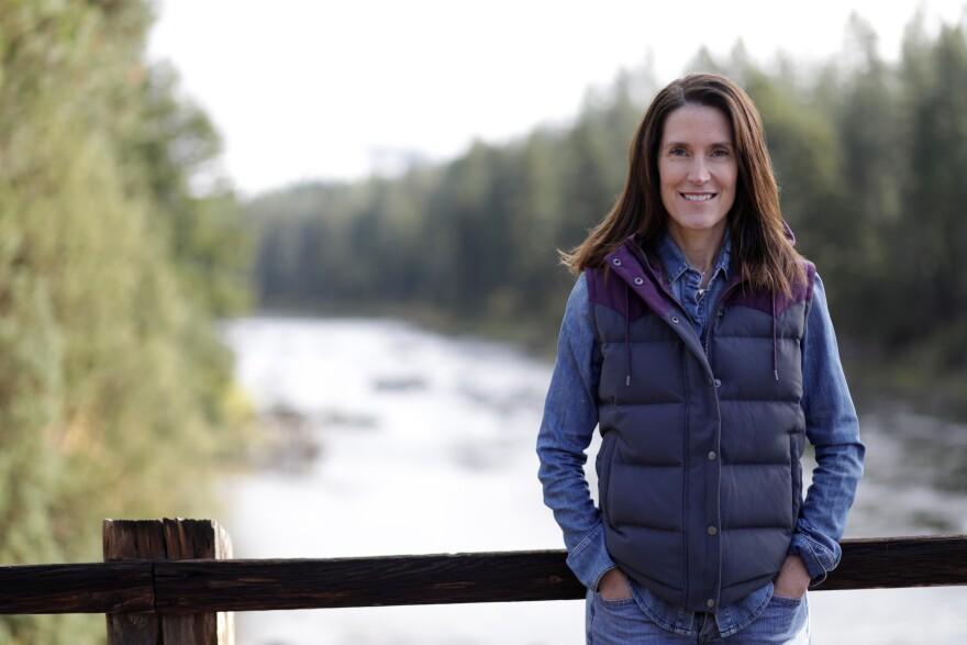 Whitney Williams standing on a bridge.
