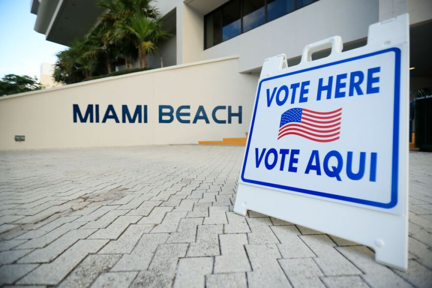 A sign directs voters to a polling location during the Florida presidential primary on March 17, 2020, in Miami Beach, Florida. (Cliff Hawkins/Getty Images)
