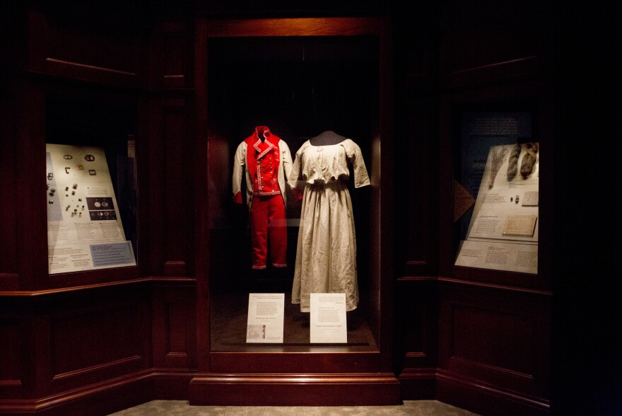 Reproductions of the types of clothing slaves wore in the mansion (center left) and in the fields (right) at Mount Vernon are on display at the exhibit.