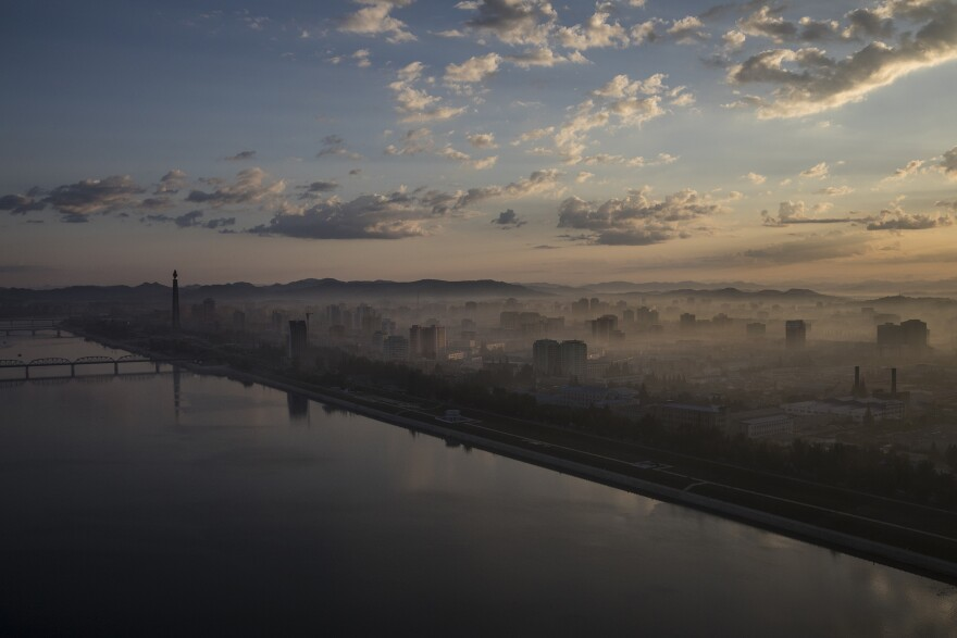 Pyongyang and the Taedong River at dawn, as viewed from the Yanggakdo Hotel. The hotel is located on an island in the middle of the river, isolating it and its guests from the rest of the city. North Korea often houses visitors there, including all of the foreign journalists covering the 70th-anniversary celebrations.