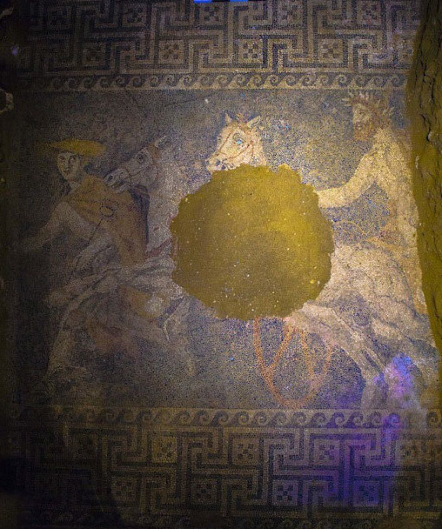 A mosaic uncovered in the huge tomb near the ancient Macedonian city of Amphipolis depicts a chariot being led by the god Hermes.