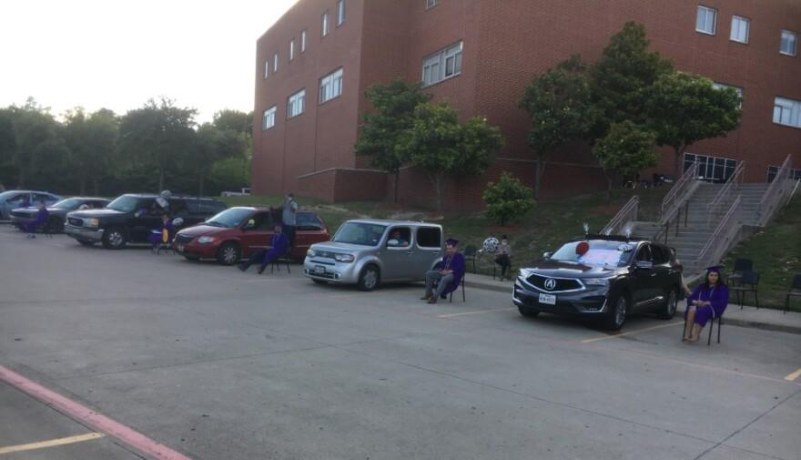 Emmett Conrad High's Collegiate Academy graduates kept a safe distance in the school's back parking lot, as arranged by school staff.