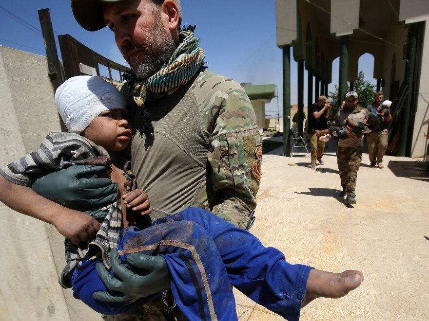 Medics from a U.S. group provided care for wounded civilians during the Iraqi government's offensive to retake the city of Mosul from ISIS.