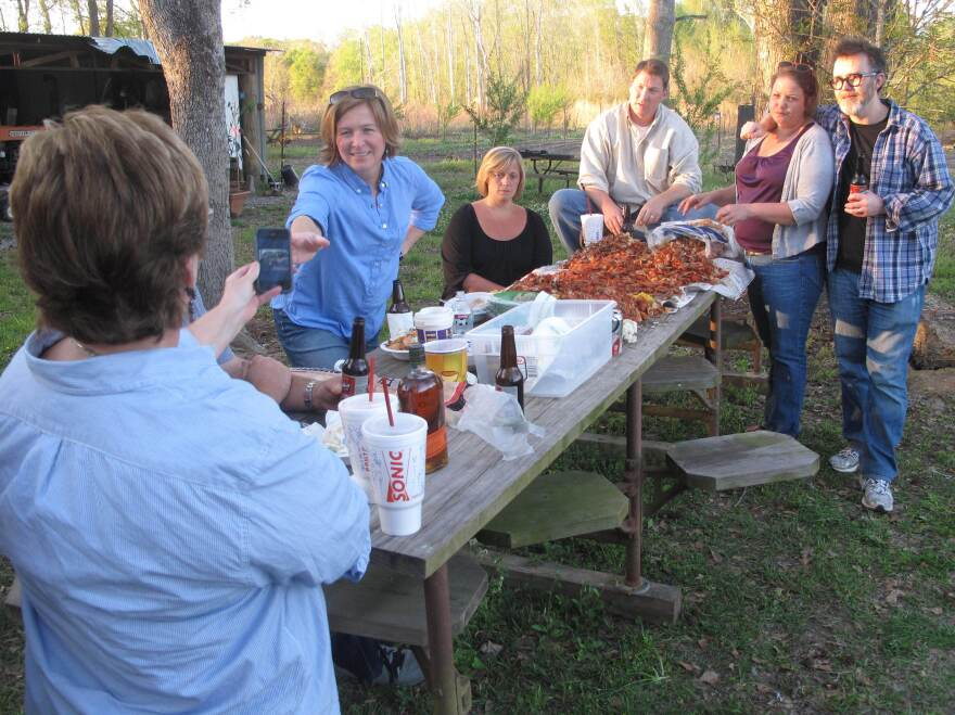"""Ruthie Leming's friends and Rod Dreher (right) gather for a crawfish boil at Ronnie Morgan's camp by the Starhill Riviera. """"When I'm gone,"""" Morgan says, """"the only thing that's going to show up to say I was here is the people I left behind."""""""