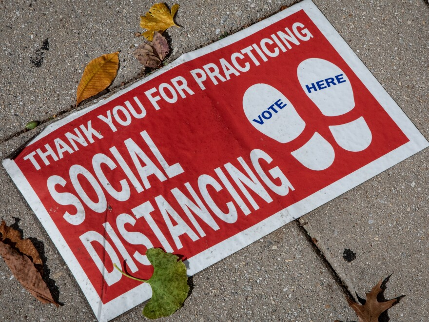 "A social distancing sign on the ground. ""Social distancing"" was one of dozens of terms highlighted by researchers in Oxford Languages' 2020 Word of the Year campaign."