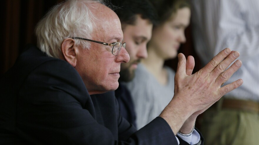 Sanders waits to speak at a town hall meeting last December in Ames, Iowa. Sanders is a socialist, but it's not a word he often uses on the campaign trail to define himself.