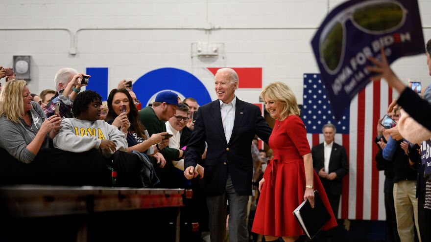 Biden and his wife, Jill, arrive at a town hall event in Des Moines, Iowa, on Feb. 2. Biden would finish a disappointing fourth in the Iowa caucuses.