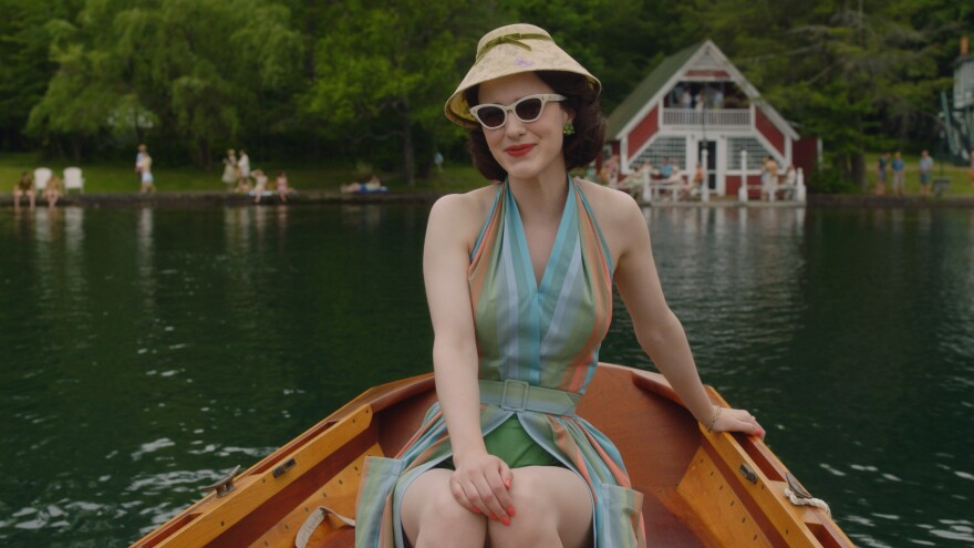 "In the second season of <em>The Marvelous Mrs. Maisel,</em> Midge (Rachel Brosnahan) visits the Catskills. Costume designer Donna Zakowska says this outfit ""in the boat with a funny lampshade hat"" was among her favorites."