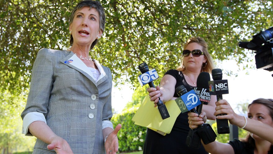 Carly Fiorina speaks to reporters after voting in the June 2010 Republican primary. She went on to lose her bid for Senate to Barbara Boxer.