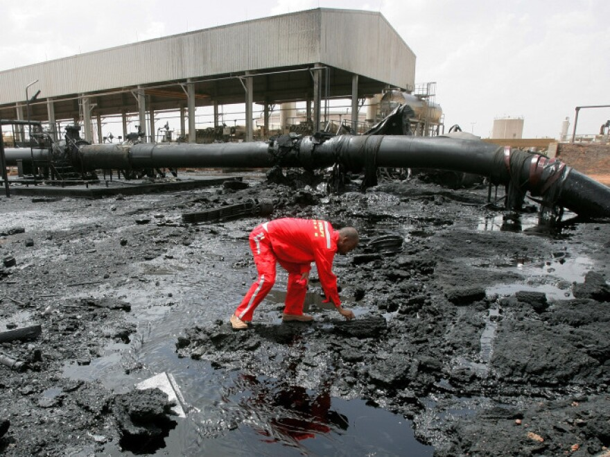 A Sudanese worker on Monday inspects damage to the country's main petroleum center in Heglig. The center was damaged when forces from South Sudan recently took over Heglig, though they have now been driven out.