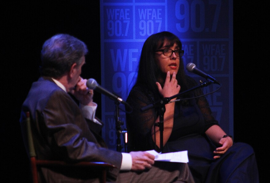 """""""Charlotte Talks"""" host Mike Collins listens to """"She Says"""" podcast host Sarah Delia at Thursday's WFAE public conversation, """"Beyond She Says."""""""