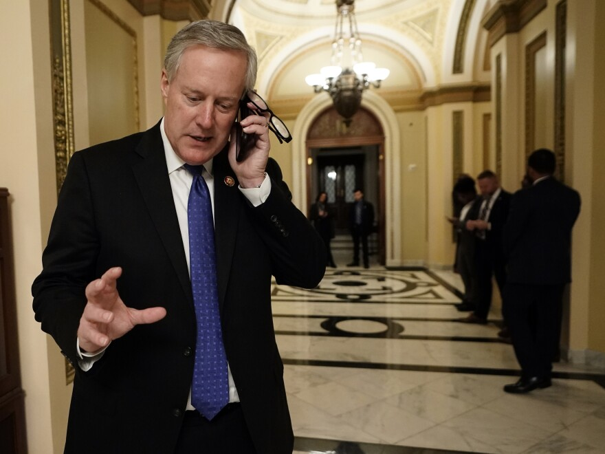 Rep. Mark Meadows, R-N.C., talks on the phone in December as the House of Representatives debated impeaching President Donald Trump on two charges.