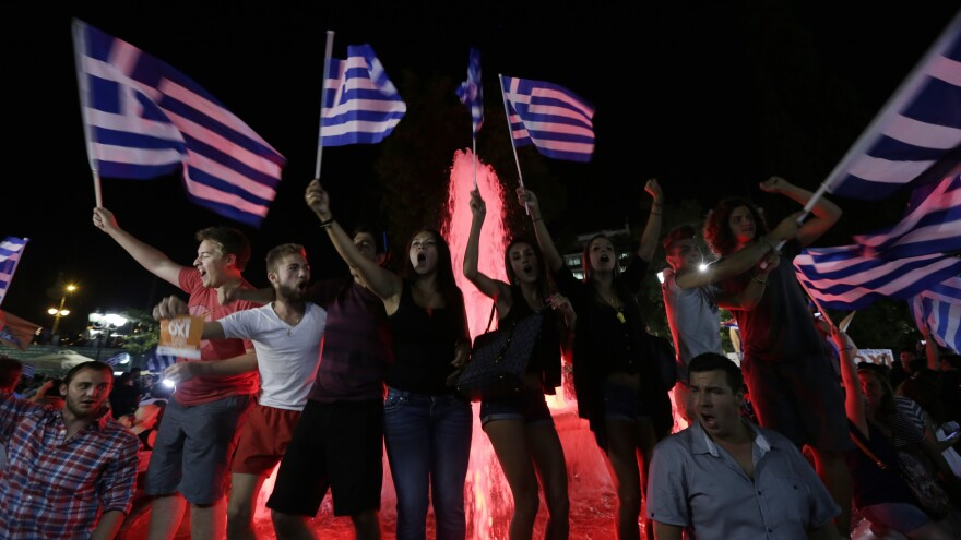 "Greek supporters of the ""no"" vote celebrate at Syntagma Square in Athens on Sunday night after the results were announced. Greeks overwhelmingly rejected the demands of creditors for more austerity in return for rescue loans. But the country has no clear way out of its financial crisis."