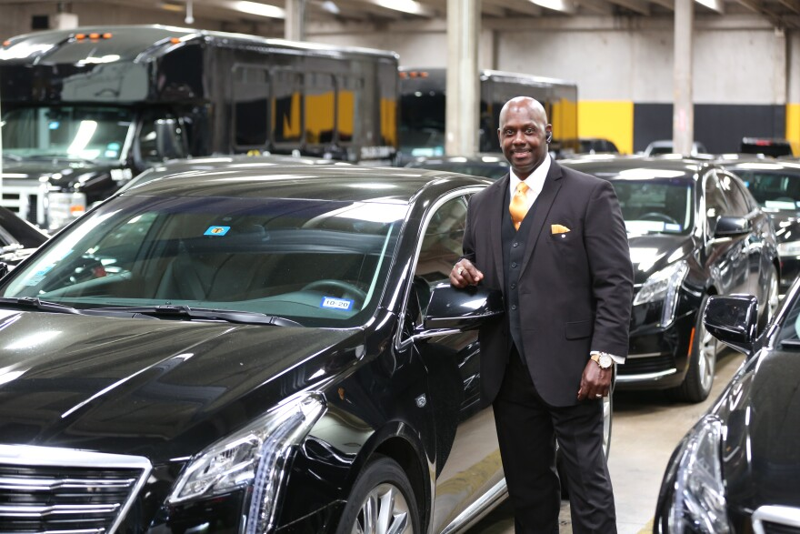 Chauffeur Maurice Scott stands in the garage of Premier Transportation Services in Dallas.