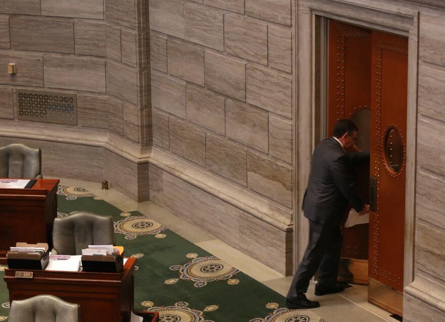 Senators leave the Missouri Senate chamber on the last day of the legislative session.