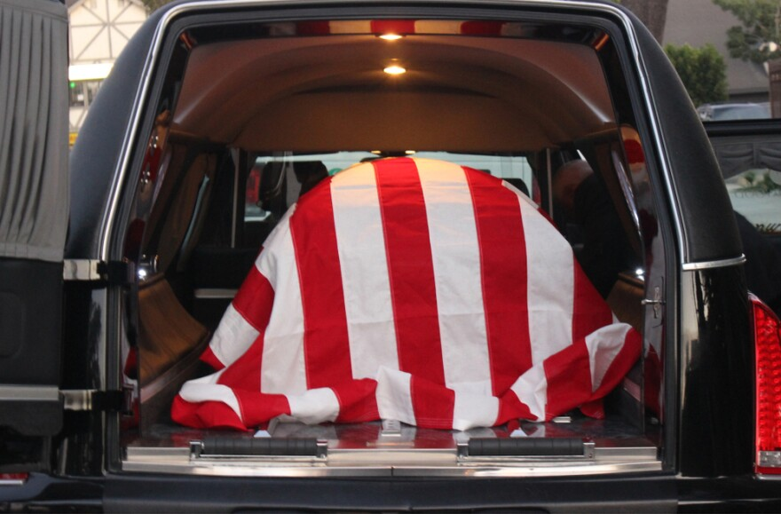 flag-draped coffin - veteran suicide