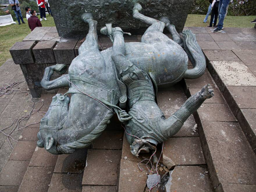 The statue of Sebastián de Belalcázar, a 16th century Spanish conquistador, lies on the ground after it was pulled down by Indigenous people in Popayán, Colombia, earlier this year.