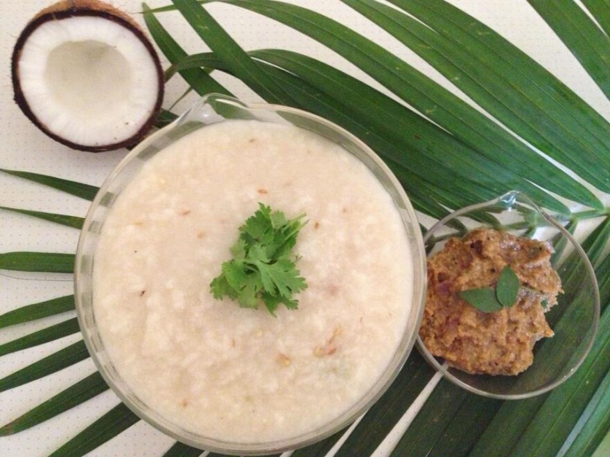 "A bowl of <em>nombu kanji</em> prepared by Tamil cookbook author and food blogger Hazeena Seyad. ""Rice is the staple food in Tamil Nadu and Kerala,"" she explains, ""and the <em>nombu kanji,</em> with its rice and lentil base, offers a nutritious and accessible meal after a long day's fast."""