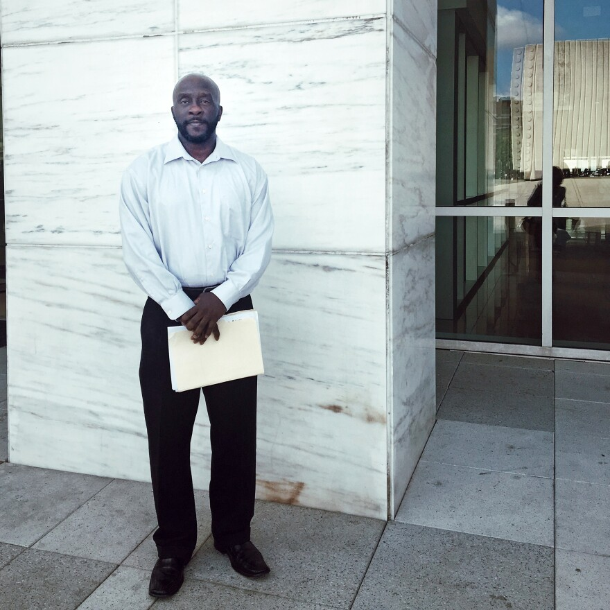 Marc Wilson standing outside the George L. Allen, Sr. Courts Building in downtown Dallas on Sept. 10, 2019. Much of the child support debt he racked up in prison has been reduced. But he's still far behind, and relief is tempered by feelings of guilt.