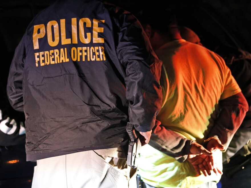 U.S. Immigration and Customs Enforcement agents came under criticism for continuing enforcement operations despite widespread orders by state and local leaders to begin ramping up social distancing efforts.