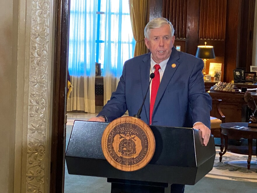 Gov. Mike Parson speaks with reporters last month at the Capitol in Jefferson City.