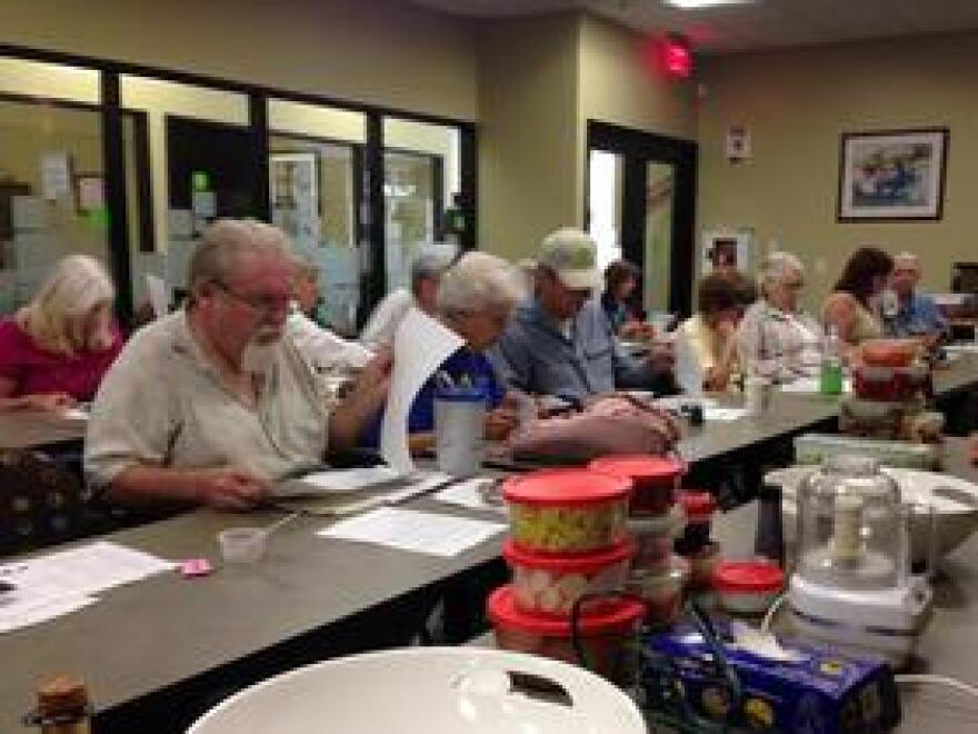 Participants in a healthy cooking class with Chef Mabel Guzman