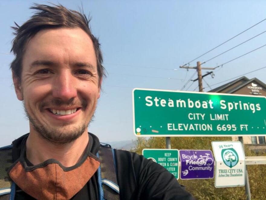 Nate snaps a selfie in front of the final town on his bicycle journey: Steamboat Springs, Colorado.