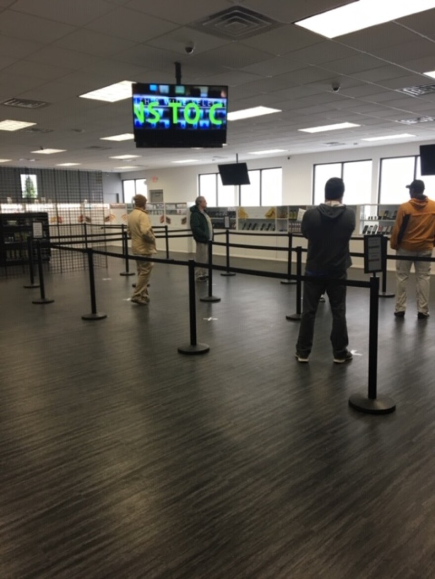 Customers line up on X's spaced six feet apart in The Green Solution dispensary in Sauget on March 19th. It's one measure the dispensary is taking to slow the spread of the coronavirus.