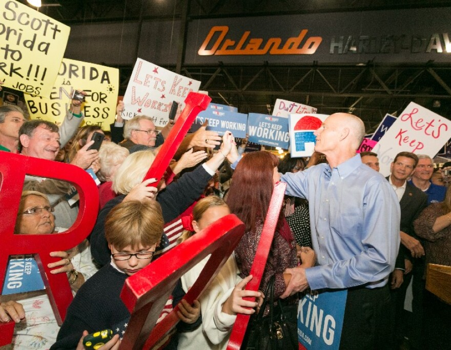 Gov. Rick Scott greets supporters at a campaign event at Orlando Harley-Davidson in November.