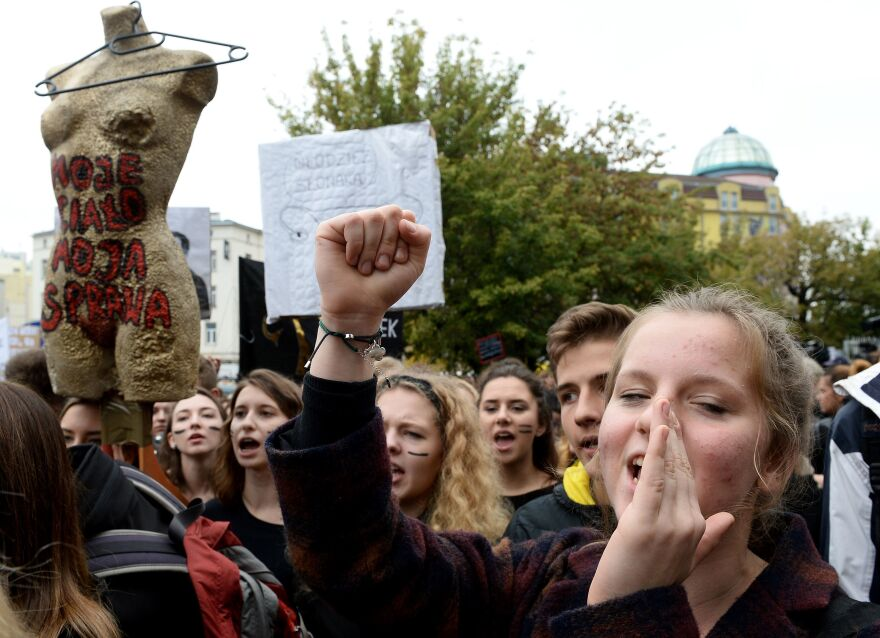 """Polish women and men in Warsaw take part in a nationwide strike and demonstration on """"Black Monday"""" to protest a legislative proposal for a total ban of abortion. Thousands of women dressed in black protested across the country. After the protests, government leaders began backing away from the proposed ban."""