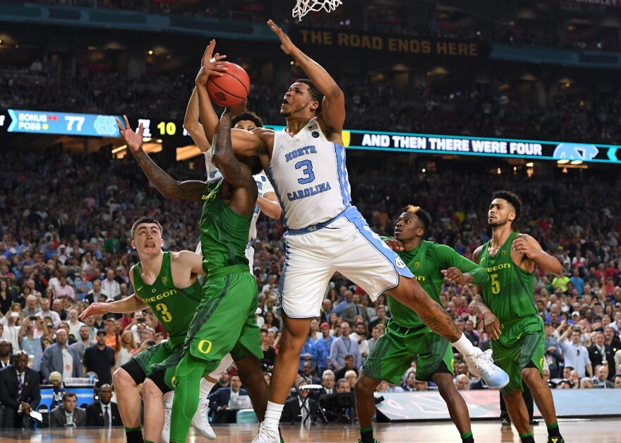 North Carolina's Kennedy Meeks (3) of the and Jordan Bell (1) of the Oregon get tangled up during the Final Four Semifinal.