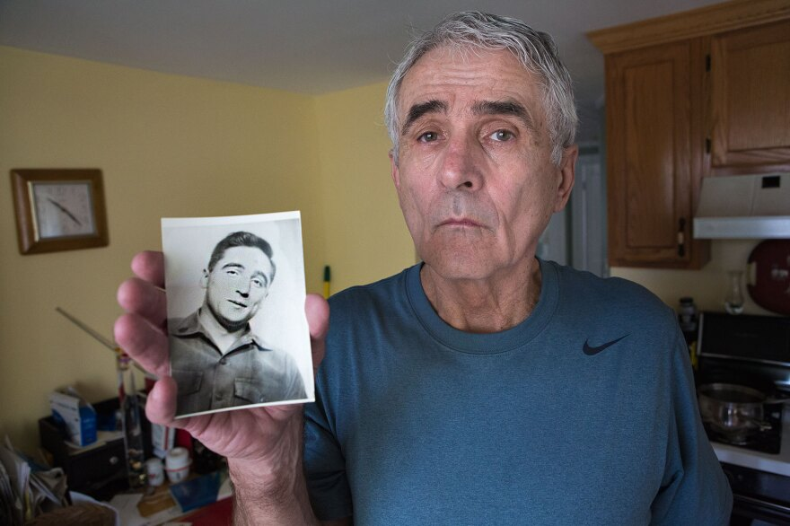 Richie McCarthy holds a photo of his brother, Staff Sgt. John McCarthy, who died during the Vietnam War.