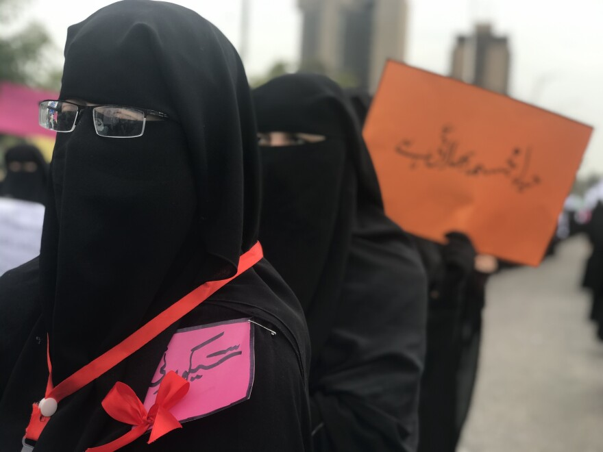 Women from a hardline religious seminary in the Pakistani capital Islamabad form military style rows in a counter protest against an International Women's Day march - held across the road.