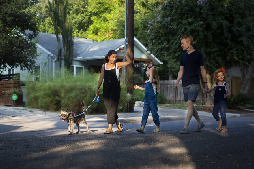 Cheasty Anderson walks her dog with her husband, Hansen, and daughters Caroline (center) and Mary Dale.