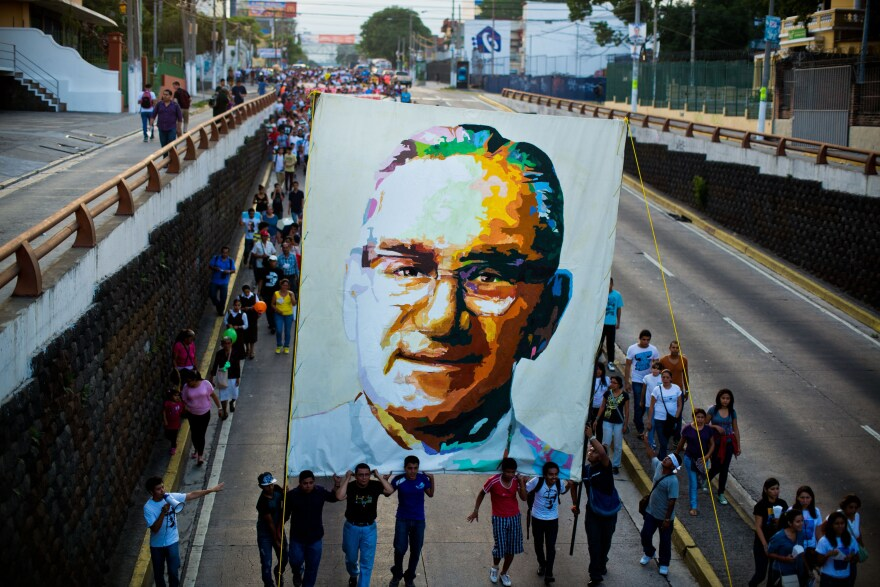 Catholics march in San Salvador on March 22, 2014, during the commemoration of the 33th anniversary of Romero's murder.