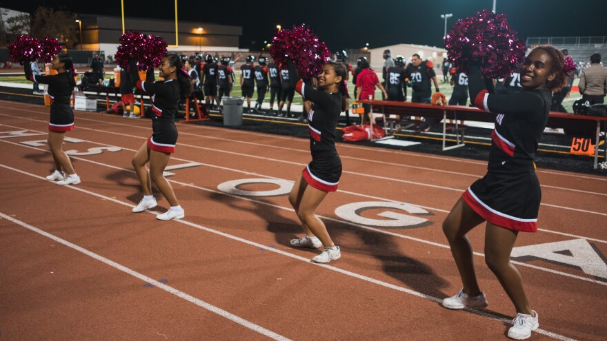 Cheerleaders at James Logan High School in Union City, Calif., perform at a football game.