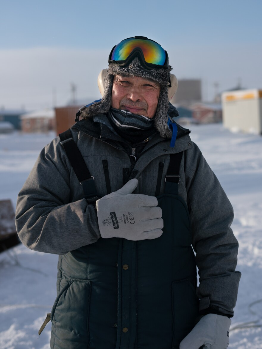 Tribal Administrator Robert Pitka stands outside in Toksook Bay in January preparing to ride a snow machine (known in the Lower 48 as a snowmobile) to neighboring Nightmute. There are no paved roads between the two villages.
