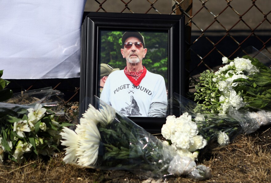Members of the Puget Sound John Brown Gun Club hold a memorial service for Willem van Spronsen on July 28, 2019, at the site where he was killed by law enforcement outside an Immigration and Customs Enforcement facility in Tacoma, Washington.