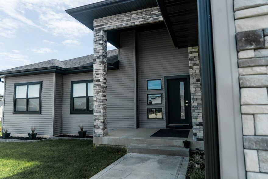 Stone pillars mark the entryway of a new home.