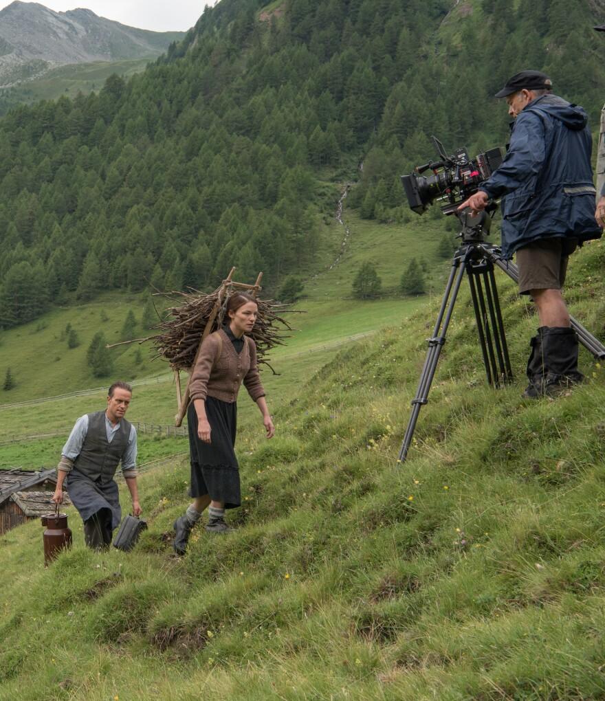 August Diehl, Valerie Pachner and Director of Photography Joerg Widmer on the set of <em>A</em><em> Hidden Life</em>.