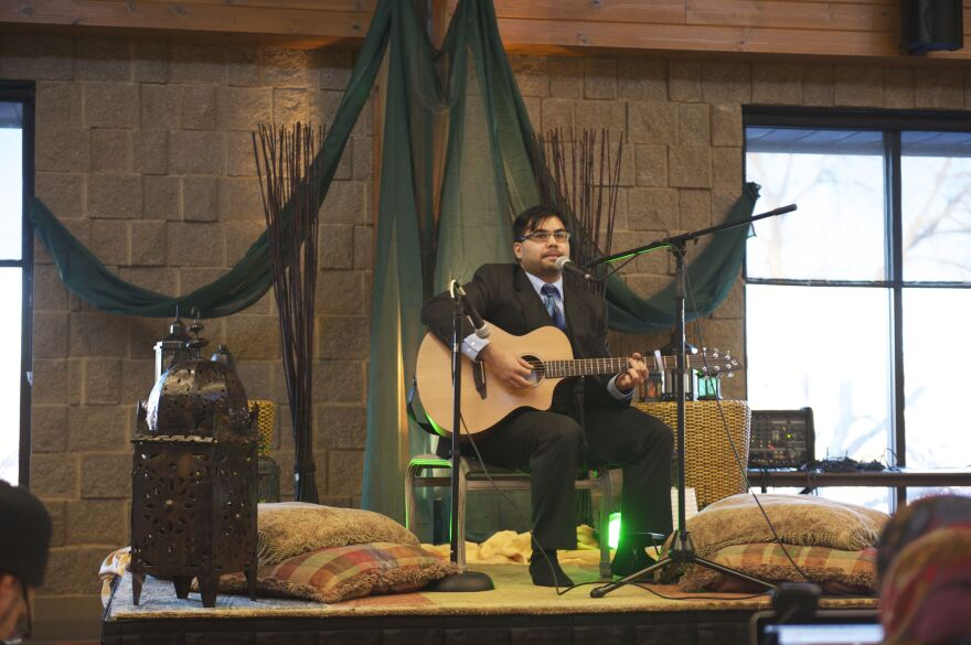 """Zain Lodhia plays an original song at a Mawlid, a birthday celebration for the Prophet Muhammad. The event was sponsored by the Webb Foundation, a so-called """"Third Space"""" Muslim faith community outside the traditional mosque."""