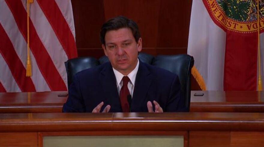 Gov. Ron DeSantis speaking during a news conference