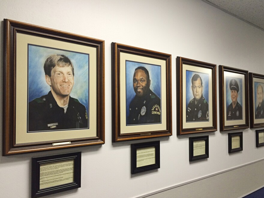 The hallway of the Dallas police academy is lined with portraits of every Dallas officer who has been killed in the line of duty.