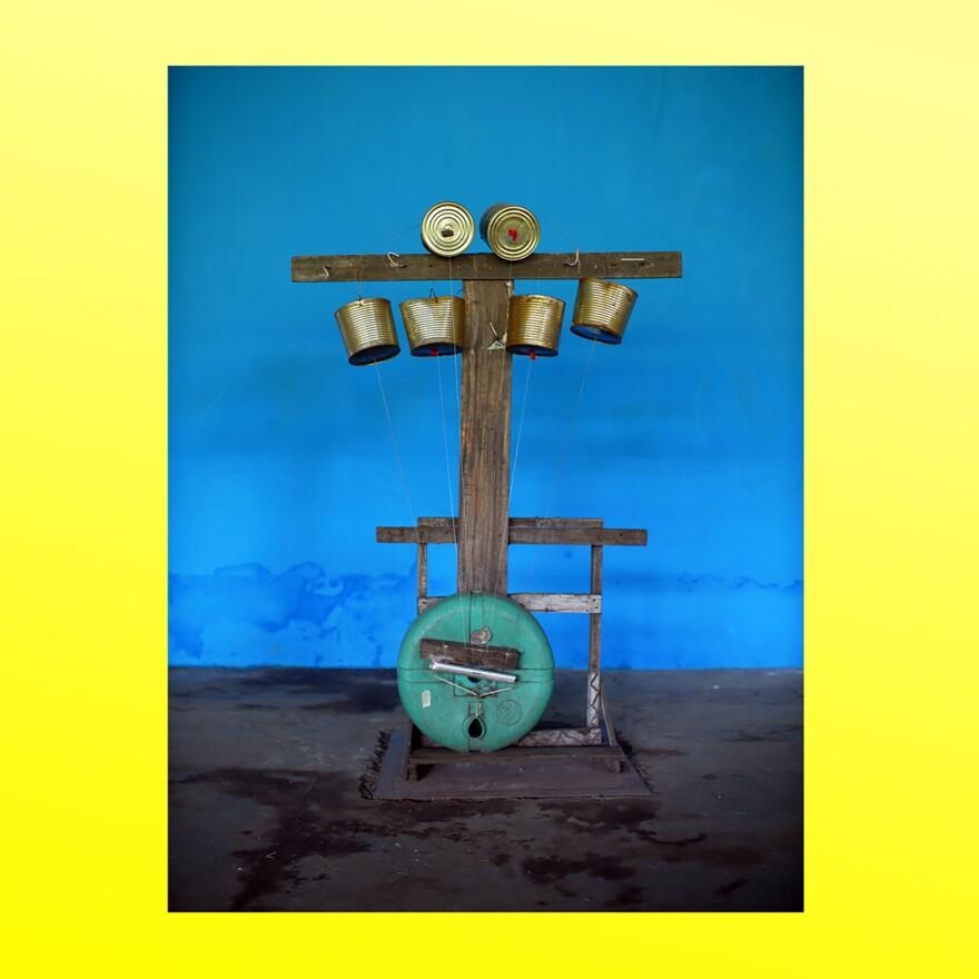 """KOKOKO! member Dido Oweke built the """"Jesus Crisis"""" bass harp in 2016."""