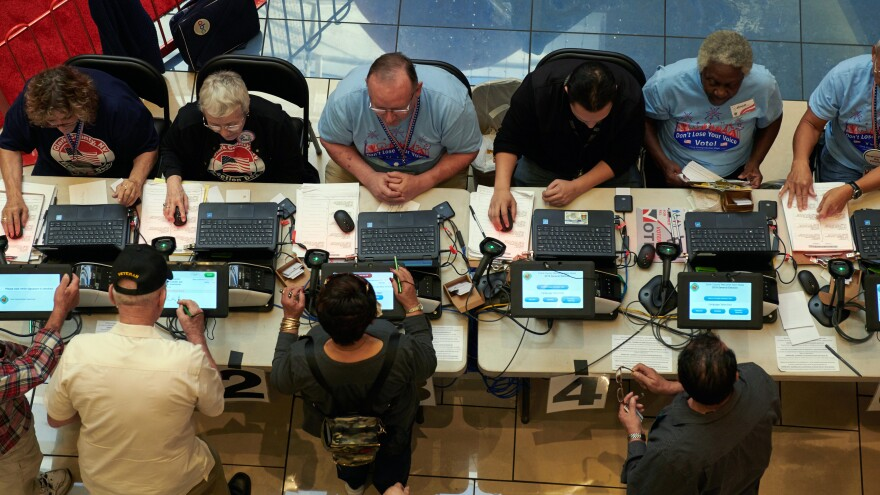 Voters check in using electronic poll books at a polling station in Las Vegas last November.