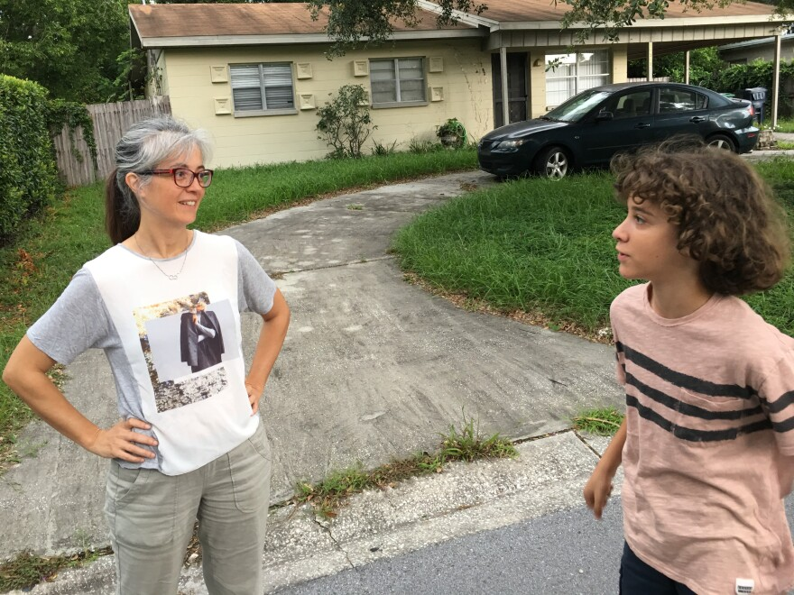 Laura Macia speaks with her son in front of the area where he fell off a hoverboard and broke his leg months earlier.